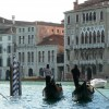 Take a gondola ride along the Grand Canal and the small canals of Venice